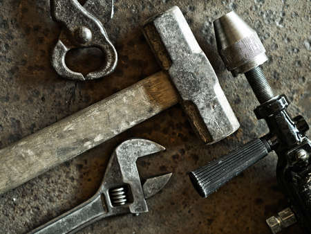 workbench: Old tools over rusty metal background