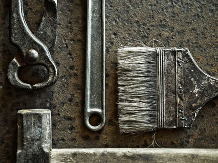 pincers: Hammer, brush, pincers and wrench over rusty metal background Stock Photo