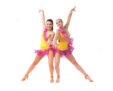 showgirl: Two female salsa dancers in colorful dresses over white background