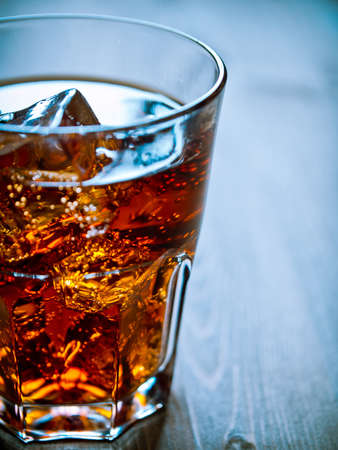 fizzy: Glass of cold drink over ice