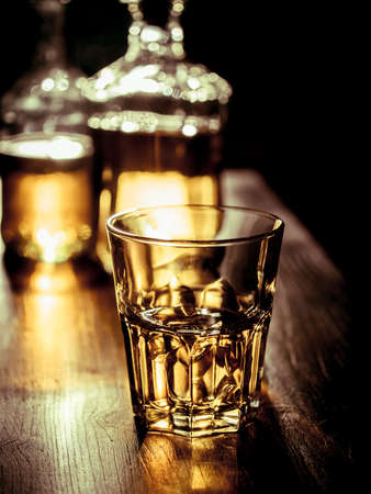 Whiskey on the rocks wiith backlight and strong reglections