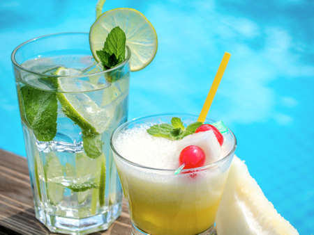 pool side: Two summer cocktails on a pool side Stock Photo