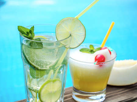 maraschino: Two summer cocktails on a pool side Stock Photo