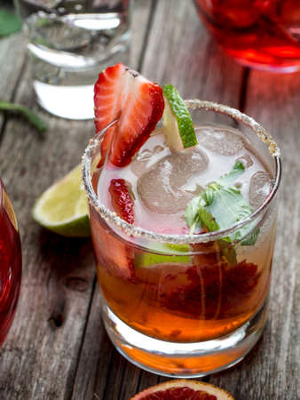 srawberry: Strawberry mojito cocktail on a wooden table
