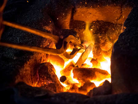 Blazing furnace with burning coal at the blacksmith's Standard-Bild
