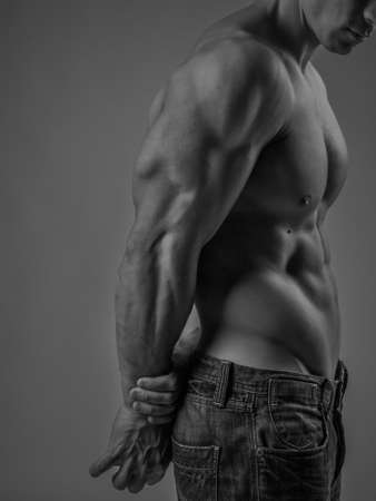 sixpack: Side view of a muscular young man posing shirtless