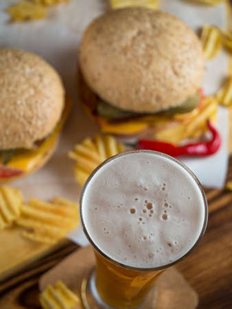junk: Freshly made spicy cheeseburgers with crisps Stock Photo