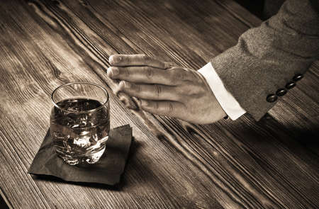 Gesture indicating refusal to drink, no to whiskey