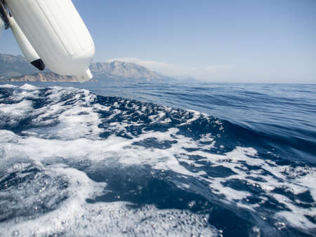 Seawater splashes at the board of a sailing boat Stok Fotoğraf