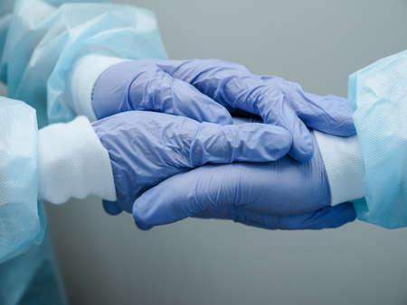 Handshake of two doctors' hands in medical gloves