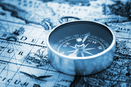 old macro: Compass on vintage map Stock Photo
