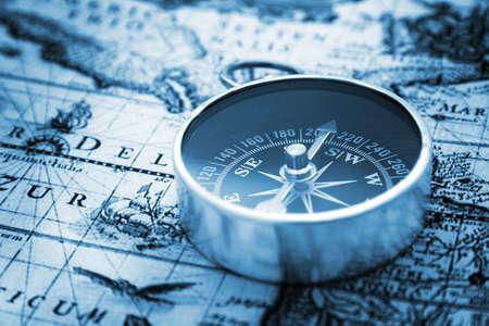 Compass on vintage map Reklamní fotografie