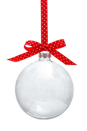 Transparent Christmas ball hanging on red ribbon Foto de archivo