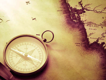 antique compass on vintage map background