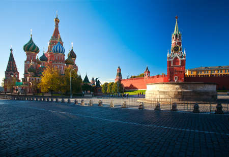 spassky: Intercession Cathedral St. Basils and the Spassky Tower of Moscow Kremlin at Red Square in Moscow. Russia. Stock Photo