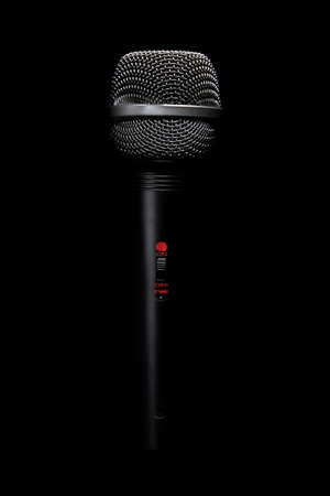 Black classic microphone on black dark background