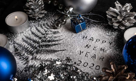 New Year 2020 background. Silhouette of flour on blackbackground Stock Photo