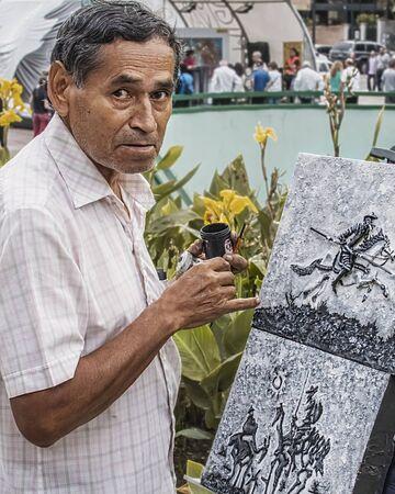 caracas: Artist painting on the street in Plaza Altamira, Caracas Venezuela