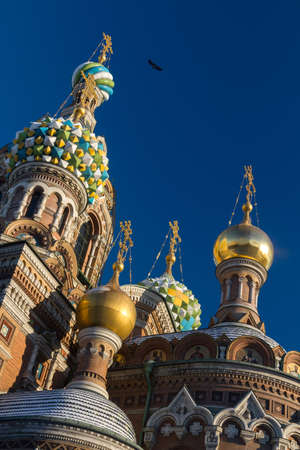 The famous cathedral in St. Petersburg, on the Moika River, the Cathedral of the Savior on Spilled Blood in the winter under the snow and bright sun lit photo