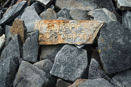 On the roads of Nepal, in mountainous areas, you can find a lot of stones with mantras written on them - it is a symbol of Buddhism in the Himalayas photo