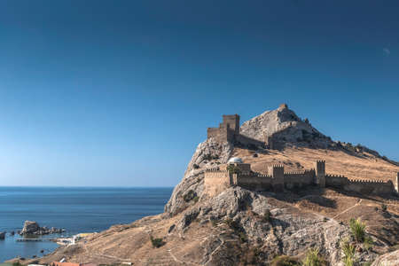 impregnable: Ancient Genoese fortress impregnable on the southern coast of the Crimean Peninsula in the background of the Black Sea Stock Photo