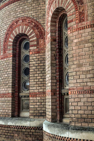 redbrick: Windows on the stone, red-brick walls in the building of the Chernivtsi University in western Ukraine