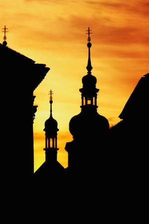 Silhouettes of Gothic towers on the background of orange sunset sky in the Czech capital, Prague 版權商用圖片