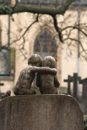 twentieth: The graves and monuments of the early twentieth century on the famous historic Vysehrad cemetery in the center of Prague, the capital of the Czech Republic, autumn day. Statue of Comforting children
