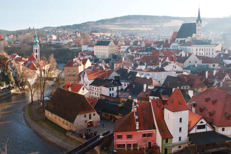 Cesky Krumlov - the famous Czech city, part of the World Heritage, UNESCO. The red roofs of the city and the tower on the background of bright blue sky