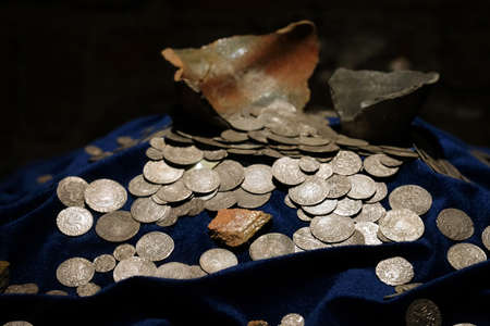 TRAKAI, LITHUANIA - JUNE 1, 2019: Historical coins in the museum of the island castle of Trakai