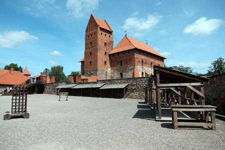 Summer view to Trakai medieval red brick castle of Lithuania with blue sky and clouds