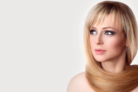 Beautiful Young Woman Spa Portrait. Long Straight Blonde Hair Around the Neck. Eyes with Natural Lases Look sideways. Beauty Face, Fresh Skin. Stock Photo