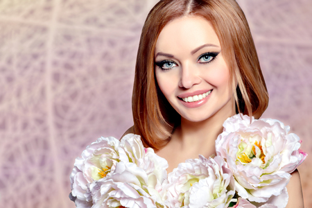 Beautiful Smiling Young Woman Model with Flowers. Beauty Face. Perfect Happy Smile. Clear Skin. White Teeth. Natural Beauty. Fresh Spring Makeup. Woman\\\\