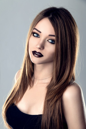 Fashion Beauty Model Girl with Black Lips and Long Hair. Dark make up.