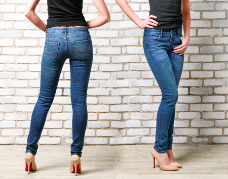 Slim Woman Wearing Blue Skinny Jeans. Back and Side View Foto de archivo