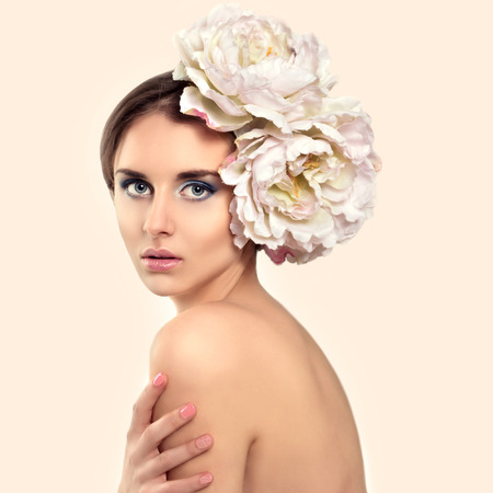 Beautiful Young Woman Model with Flower in her Hair.