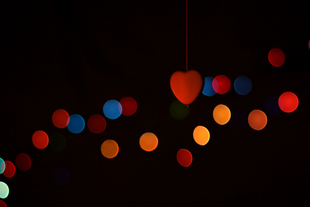 blurry lights: valentine holiday greeting card with red heart and blurry lights Stock Photo