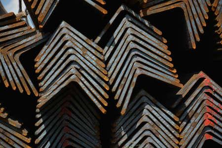 karkas: Steel angles. Stuck og L-beams on the warehouse. Metal rolled angle bar.
