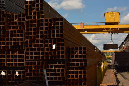 Carload steel tube. Process of metal carload in warehouse. Rectangular steel pipe carloading. Metal pipe. Steel rolled bar. Stuck of steel pipes. Steel pipe bundle in industrial stockyard.