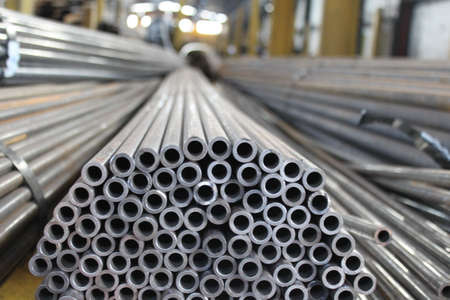 Steel tube. Metal pipe. Steel rolled bar. Stuck of steel pipes. Steel pipe bundle in industrial stockyard.