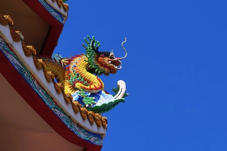 colorful dragon on top roof in the blue sky. Dragon is show power authority of king and majesty Stock Photo