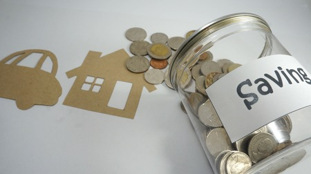 Paper cut of model house with coins and banknotes, Saving money for prepare in the future. Concepts saving money for House.