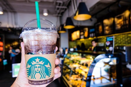 BANGKOK,THAILAND - JUNE 5,2018: The Starbucks ice coffee with cream. Starbucks  is the biggest American coffee cafe establish since 1971 at Seattle Washington DC which is famous in the world. Editöryel