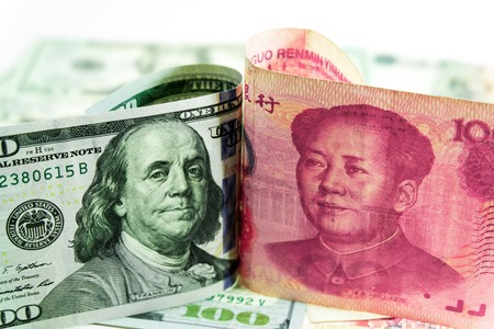 US dollar bill and China yuan banknote . America is debtor of China and now China get balance of trade with USA. so USA will increase tax for goods from China.