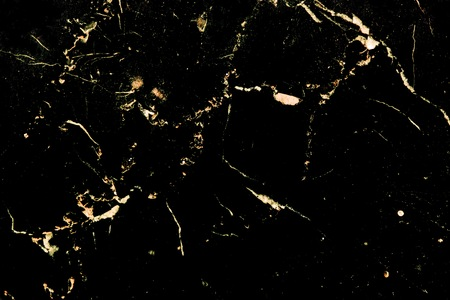 Luxury golden pattern design on black marble which it is used for poster brochure invitation cover book catalog wallpaper and texture.
