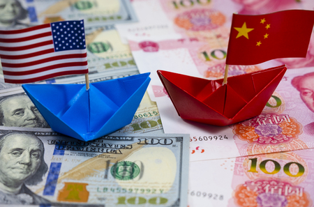US America flag on blue ship and China flag on red ship and multi color flag with white background of war trade which they counteract by increase import and export tax barrier and effect world economy Stock Photo