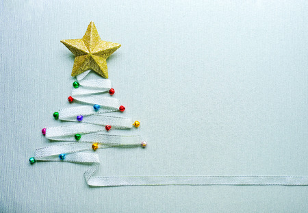 Merry Chistmas tree made from silver ribbon and gold star and small colorful ball on white background. Merry chirstmas and happy new year concept