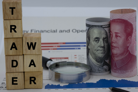 Trade war wording on wooden cubes with USA and China banknotes.Its is symbol for tariff trade war crisis or unfair business of 2 biggest economic countries in the world.