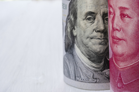 US dollar and China Yuan banknote on white background. Its is symbol for tariff trade war crisis or unfair business of 2 biggest economic countries in the world.