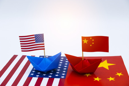 Blue ship and red ship with USA and China flags. Its is symbol for tariff trade war crisis between biggest economic country in the world.